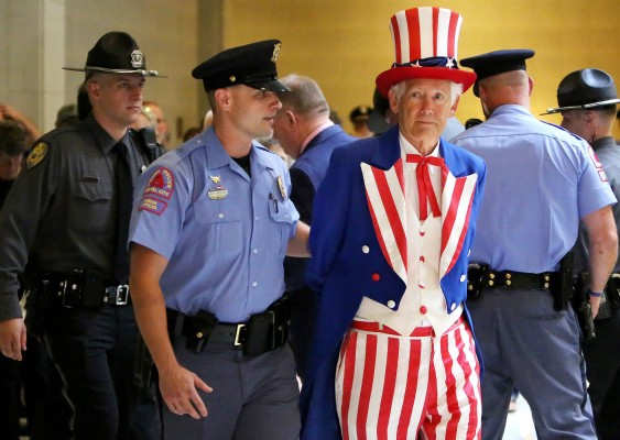 "Police arrest a man dressed as Uncle Sam as protestors rally during ""Moral Monday"" demonstrations at the General Assembly in Raleigh, N.C., Monday, July 8, 2013."