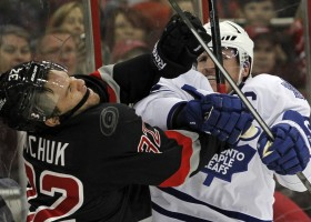 Toronto's Dion Phaneuf throws a punch at the Canes' Zach  Boychuck during the third period of an NHL game played between the Carolina Hurricanes and the Toronto Maple Leafs at the PNC Arena in Raleigh, N.C. on Thursday, January 9, 2014.