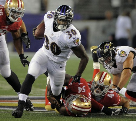 Ravens running back Bernard Pierce breaks through San Francisco defense for a first down in the second quarter as the Baltimore Ravens take on the San Francisco 49ers at M&T Bank Stadium in Baltimore, MD on Thursday, August 7, 2014.