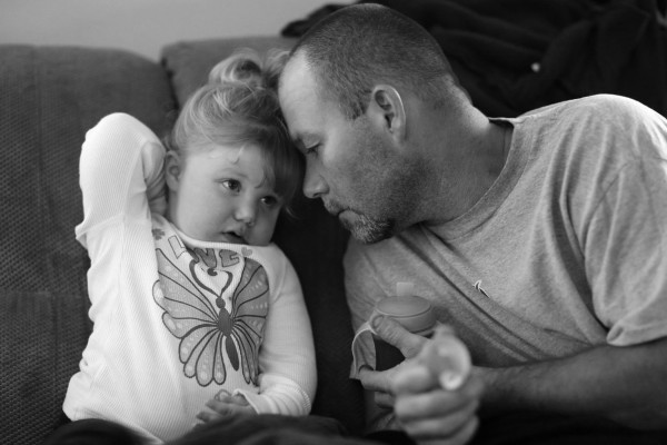 Stephen Shrum shares a moment with his daughter, Phoenix, after she calms down from being upset.