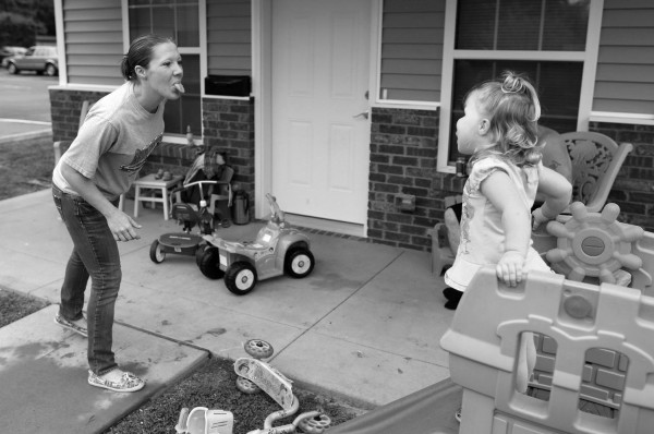 Shelly Shrum plays with her daughter, Phoenix, in their front yard.