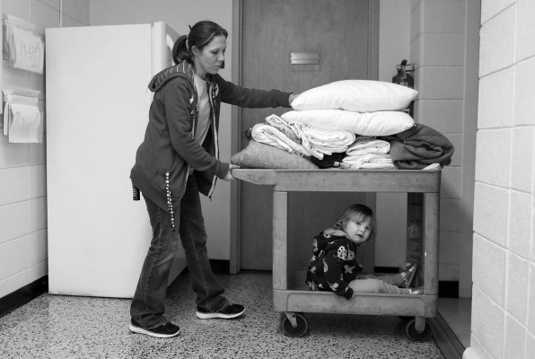 Shelly Shrum pushes her daughter, Phoenix, towards the end of her night work shift at the Daniel Pitino shelter.