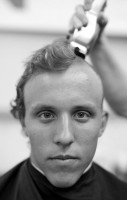 Benjamin McGrath, from West Palm Beach Florida, has his head shaved by Louise Gregory during Induction Day at the U.S. Naval Academy, Tuesday, July 1, 2014, in Annapolis, Md.