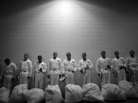 Prospective plebes stand in line after receiving their gear and before they learn how to salute during Induction Day at the U.S. Naval Academy, Tuesday, July 1, 2014, in Annapolis, Md.