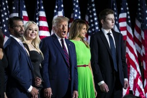 Barron Trump, from right, First Lady Melania Trump, President Donald Trump, Tiffany Trump, Donald Trump Jr., executive vice president of development and acquisitions for Trump Organization Inc., and Kimberly Guilfoyle, President Donald Trump campaign aide, stand during the Republican National Convention on the South Lawn of the White House in Washington, D.C., U.S., on Thursday, Aug. 27, 2020. Trump is asking Americans to return him to office in the speech closing the convention, arguing that voters can't trust Joe Biden or the Democratic Party to navigate the coronavirus pandemic or salve the nation's racial divisions.