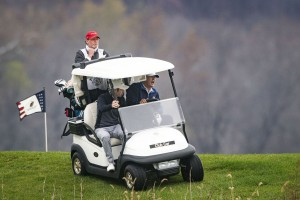 President Donald Trump drives a golf cart as he golfs at Trump National Golf Club on Sunday November 15, 2020 in Sterling, VA.