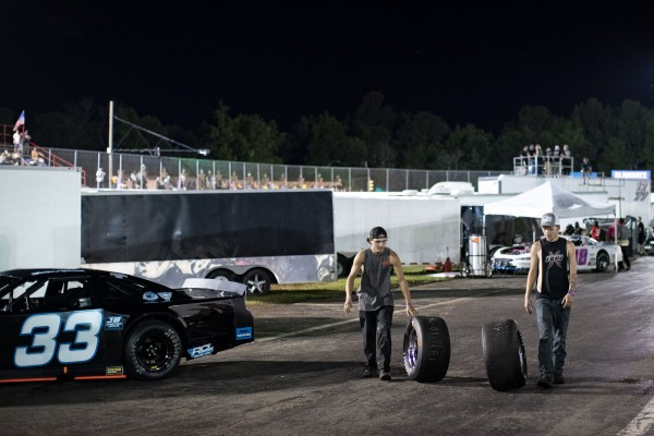 People wheel tires into storage following a race at Ace Speedway on May 30, 2020 in Altamahaw, North Carolina. Crowds accumulated at the race track for the second weekend in a row, in defiance of North Carolina Governor Roy Cooper's ban on large gatherings due to the coronavirus (COVID-19).