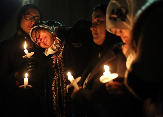 Nida Allam, a senior at North Carolina State University, rests her head on Asheen Allam, during a vigil for three people who were killed at a condominium near UNC-Chapel Hill, Wednesday, Feb. 11, 2015, in Chapel Hill, N.C. Craig Stephen Hicks appeared in court Wednesday on charges of first-degree murder in the deaths Tuesday of Deah Shaddy Barakat, his wife Yusor Mohammad and her sister Razan Mohammad Abu-Salha.