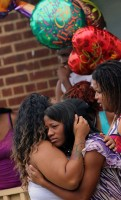 Nina Epps, 21, right, is consoled by a family member after mourning the loss of her 3-year-old daughter McKenzie Elliott, who was killed by a stray bullet on the 3600 block of Old York Road Friday afternoon.