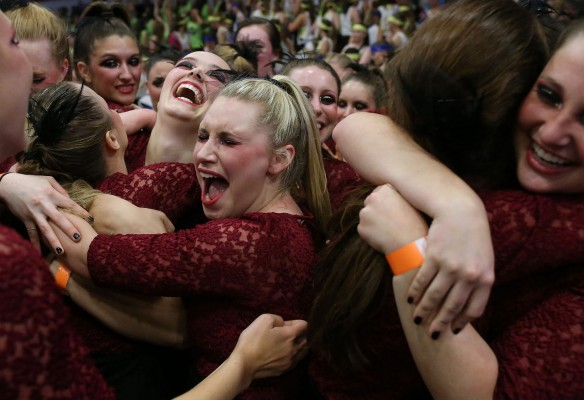 "Elon freshman Marissa Baum hugs her fellow Alpha Xi Delta sisters after their sorority won first place in the Greek Week Dance competition at Elon University, in Elon, N.C. on Wednesday, April 16, 2015. Alpha Xi Delta's theme, ""Seven Deadly Sins,"" featured different choreographed dances to each sin."