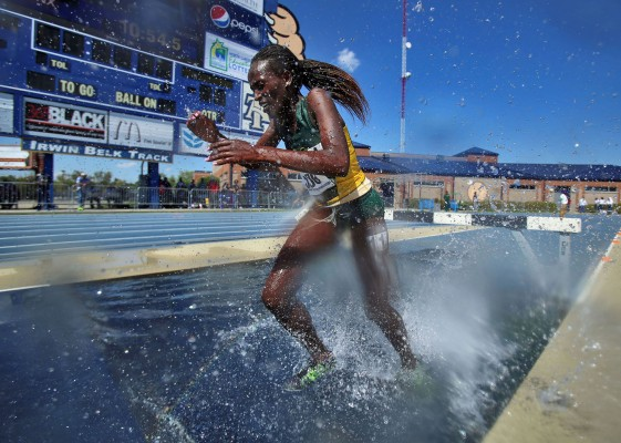 Norfolk State's Fiona Massai comes out of the water during the 3,000 meter Steeplechase during the 2014 MEAC Outdoor Championships on Saturday at the Irwin Belk Track on the campus of North Carolina A&T. Massai placed first in the event, finishing in 11 minutes, 25.78 seconds, helping bring the Spartans to a third place finish.