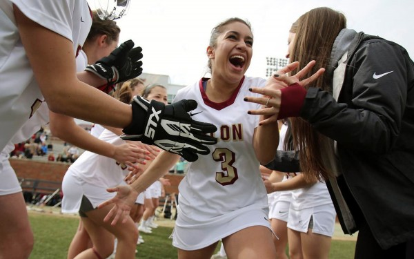 Elon midfielder Olivia Fernandez runs out of the huddle before the Phoenix's inaugural home game against Liberty on April 7, 2014 in Elon, N.C.