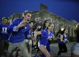 Duke students rush into Cameron Indoor Stadium for the viewing party before Duke took on Wisconsin in the NCAA national championship title on April 6, 2015 in Durham, N.C.