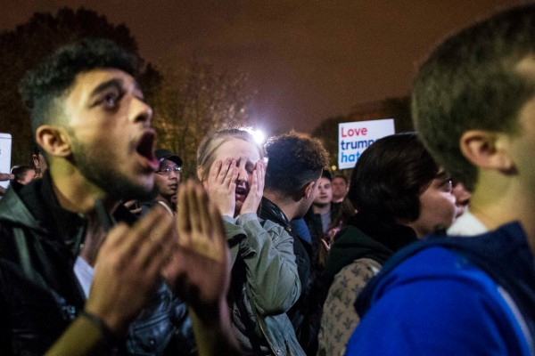 People react to the final news that Donald Trump wins the 2016 presidential race, outside of the White House in the early hours of Wednesday, Nov. 9, 2016.