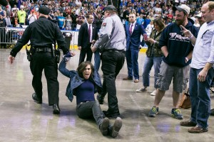 A protestor is removed by law enforcement and security as Donald Trump speaks at a campaign rally at the First Niagara Center, in Buffalo, N.Y., Monday, April 19, 2016.