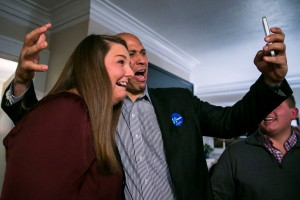 Sen. Cory Booker (D-N.J.) records a Snapchat with a supporter as he campaigns for Hillary Clinton in Des Moines, Iowa, Saturday, Jan. 23, 2016.