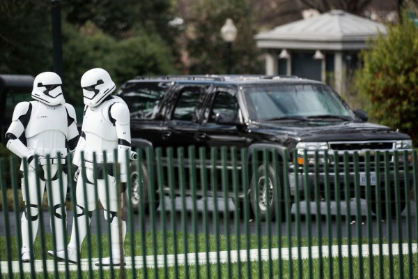 Stormtroopers wait near black SUV's during the White House Easter Egg Roll, on the South Lawn of the White House, Monday, March 28, 2016.