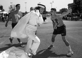 A plebe runs to catch up with her group as she is yelled at by upperclassmen detailers during Induction Day at the U.S. Naval Academy, Wednesday, July 1, 2015, in Annapolis, Md.