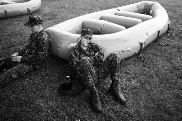 "Richard Gremillion, a freshman midshipmen, known as a ""plebe,"" from Company 5, rests before the next challenge during Sea Trials, a day of physical and mental challenges that caps off the freshman year at the U.S. Naval Academy in Annapolis, Md., on Tuesday, May 17, 2016."
