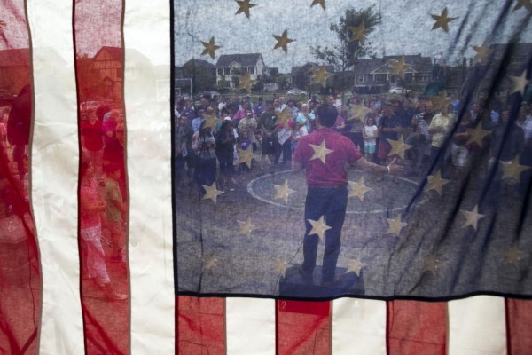 Republican presidential candidate Sen. Marco Rubio, R-Fla., speaks during a Family Night event at Dean Park, as seen from behind an American flag, in Ankeny, Iowa, Monday, August 17, 2015.