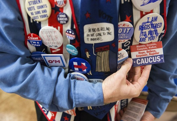 John Olsen, who is commonly known as Dr. Vote, from Ankeny, shows off various caucus pins on his vest at an Ankeny Area Democrats event at the United Auto Workers Local 450 union in Des Moines, Iowa, on Thursday, Jan. 14, 2016.