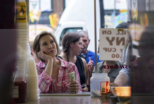 "Republican presidential candidate Carly Fiorina waits her turn in line to purchase a ""diabetic lemonade"" at the Iowa State Fair in Des Moines, Iowa, Monday, August 17, 2015. Florina's husband, Frank, was recently diagnosed with diabetes and Florina has agreed to quit sugar with her husband."
