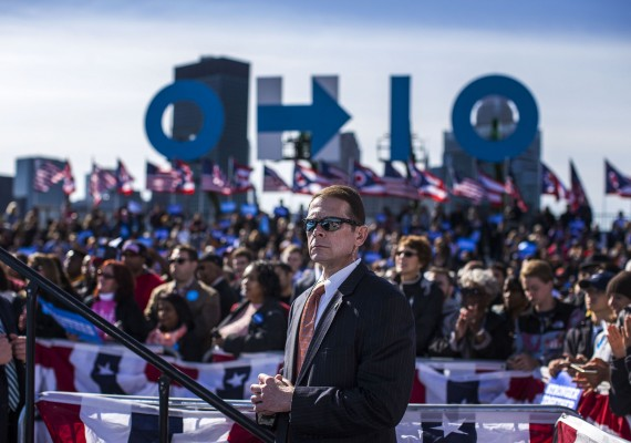 A Secret Service agent watches as President Barack Obama speaks at a campaign event for Democratic Presidential candidate Hillary Clinton, at the Cleveland Burke Lakefront Airport, Friday, Oct. 14, 2016 in Cleveland, Ohio.