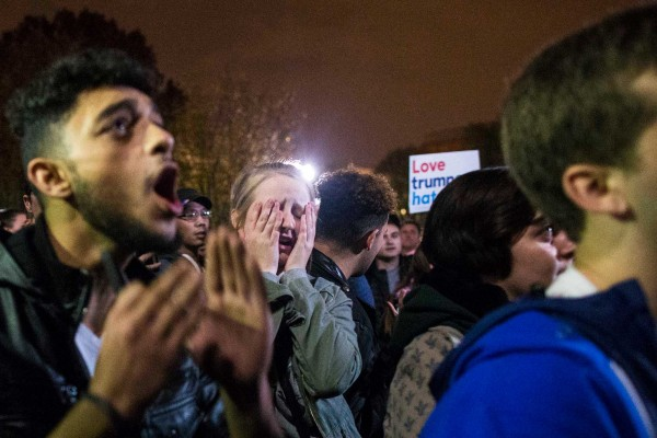 People react to the final news that Donald Trump wins  outside of the White House in the early hours of Wednesday, Nov. 9, 2016 after Donald Trump won the 2016 presidential race in Washington.