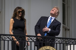 Don't Look Up: President Donald Trump, beside first lady Melania Trump, looks up at the sun to view the solar eclipse from the Blue Room balcony of the White House, in Washington, Aug. 21, 2017. Millions of people ventured to a spot on the path of totality hoping to catch a glimpse of the rare celestial event.