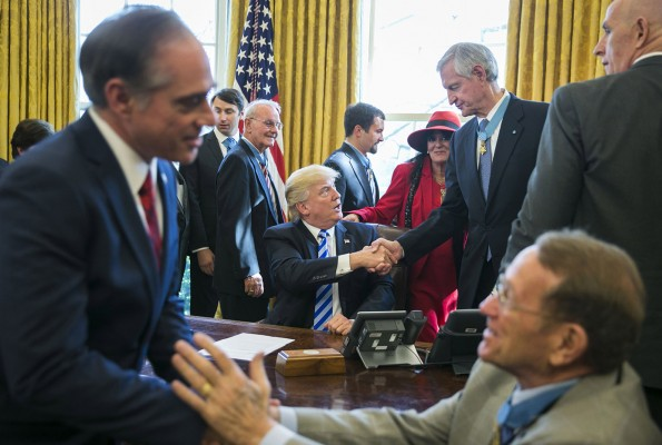 President Donald Trump meets with Medal of Honor recipients, Friday, March 24, 2017 in the Oval Office of the White House in Washington.