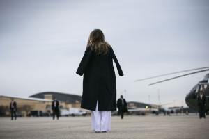 First Lady Melania Trump waits for her husband, President Donald Trump, before boarding Air Force One, headed to West Palm Beach, Fla., at Joint Base Andrews, Md., Friday, Feb. 10, 2017.