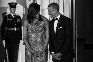 President Barack Obama and First Lady Michelle Obama welcome Italian Prime Minister Matteo Renzi and Mrs. Agnese Landini for a State Dinner in their honor at the White House in Washington, Tuesday, Oct. 18, 2016. The First Lady wore a floor length, rose gold chainmail gown designed by Atelier Versace.
