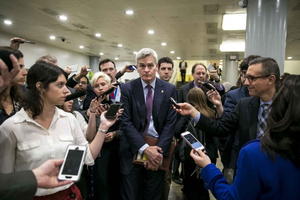 Sen. Bill Cassidy (R-La.) speaks with reporters, following a lunch with President Donald Trump, on Capitol Hill, Nov. 28, 2017 in Washington.