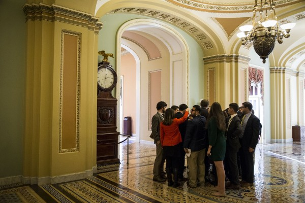 Reporters gather around Sen. Susan Collins (R-Maine) as she speaks with reporters after a meeting with Senate Republicans, on Capitol Hill, Nov. 29, 2017 in Washington.