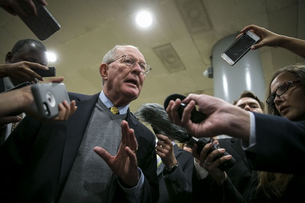 Sen. Lamar Alexander (R-Tenn.) speaks with reporters about his new healthcare proposal with Sen. Patty Murray (D-Wash.), in between a series of votes, Oct. 18 2017, on Capitol Hill in Washington.