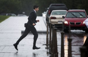 Rep. Paul Ryan, R-Wi., runs through the rain to his car after final votes in the House of Representatives outside of the U.S. Capitol in Washington, on Thursday, Oct. 1, 2015.