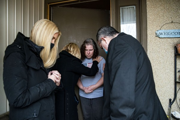 White House senior adviser Ivanka Trump and Pastor Paula White pray with Marta Torres, who's son is receiving a kidney transplant today, while delivering food boxes as part of the Farmers to Families Food Box Distribution program in Woodbridge, Virginia on Monday, on Monday, December 14, 2020 in Woodbridge, VA.