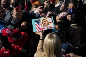 White House senior adviser Ivanka Trump signs autographs on photographs, hats, and signs, during a rally as she campaigns for President Donald Trump, at the Mahoning County Career and Technical Center, in Canfield, Ohio, on Saturday, Oct. 31, 2020.