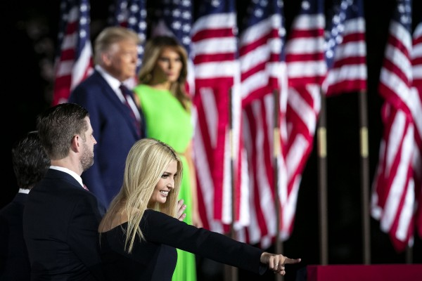 Ivanka Trump, assistant to President Donald Trump, points to the crowd as President Donald Trump and First Lady Melania Trump arrive during the Republican National Convention on the South Lawn of the White House in Washington, D.C., U.S., on Thursday, Aug. 27, 2020. President Donald Trump will ask Americans to return him to office in a speech closing the convention, arguing that voters can't trust Joe Biden or the Democratic Party to navigate the coronavirus pandemic or salve the nation's racial divisions.