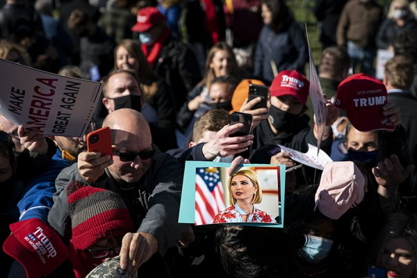 CANFIELD, OH – OCTOBER 31: White House senior adviser Ivanka Trump signs autographs on photographs, hats, and signs, during a rally as she campaigns for President Donald Trump, at the Mahoning County Career and Technical Center, in Canfield, Ohio, on Saturday, Oct. 31, 2020. (Photo by Al Drago for The Washington Post)