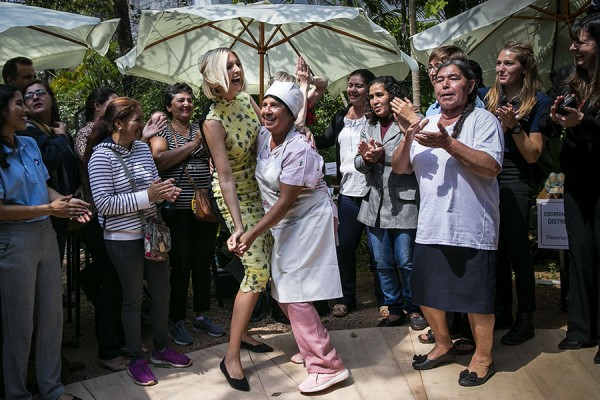 Ivanka Trump, assistant to U.S. President Donald Trump, dances with a woman in a courtyard following a women's economic empowerment event in Asuncion, Paraguay, on Friday, Sept. 6, 2019.