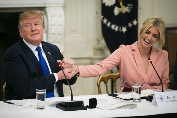 U.S. President Donald Trump greets Ivanka Trump, assistant to U.S. President Donald Trump, during an American Workforce Policy Advisory board meeting in the State Dining Room of the White House in Washington, D.C., U.S., on Wednesday, March 6, 2019. Photographer: Al Drago/Bloomberg