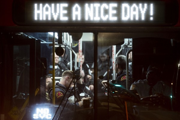 Members of the Raleigh Police Department rest in a bus in downtown Raleigh, N.C., on May 31, 2020 during protests following the killing of George Floyd.