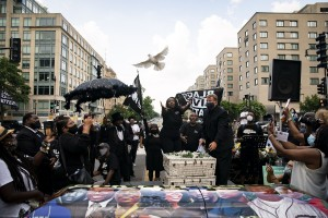 Doves are released into the air around a casket, during a New Orleans Jazz Funeral during a Black Lives Funeral at Black Lives Matter Plaza, on Sunday, July 5, 2020 in Washington, DC.