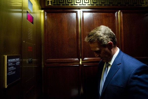 Sen. Jeff Flake (R-Ariz.) returns to his office after speaking with Sen. Chris Coons (D-Del.) during a news conference on affirming support for the U.S. intelligence community, on Capitol Hill, July 19, 2018 in Washington.