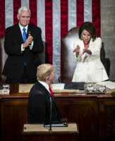 House Speaker Nancy Pelosi, a Democrat from California, right, and Vice President Mike Pence, left, applaud President Donald Trump as he arrives to deliver a State of the Union address to a joint session of Congress at the U.S. Capitol in Washington, D.C., U.S., on Tuesday, Feb. 5, 2019.