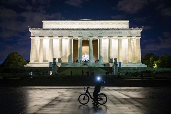 A tourist takes a photo in front of the Lincoln Memorial, Dec. 21, 2018 in Washington.